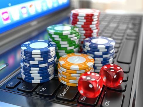 casino-gambling-online-virtual-poker-chips-dice-laptop-getty Pin Up казино – официальный сайт